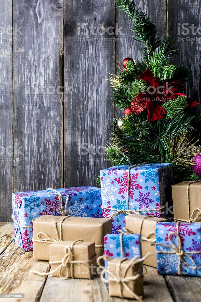 Christmas Tree with Gifts, Wooden Background stock photo