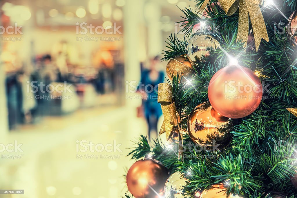 Christmas tree with gold decoration in shopping mall stock photo
