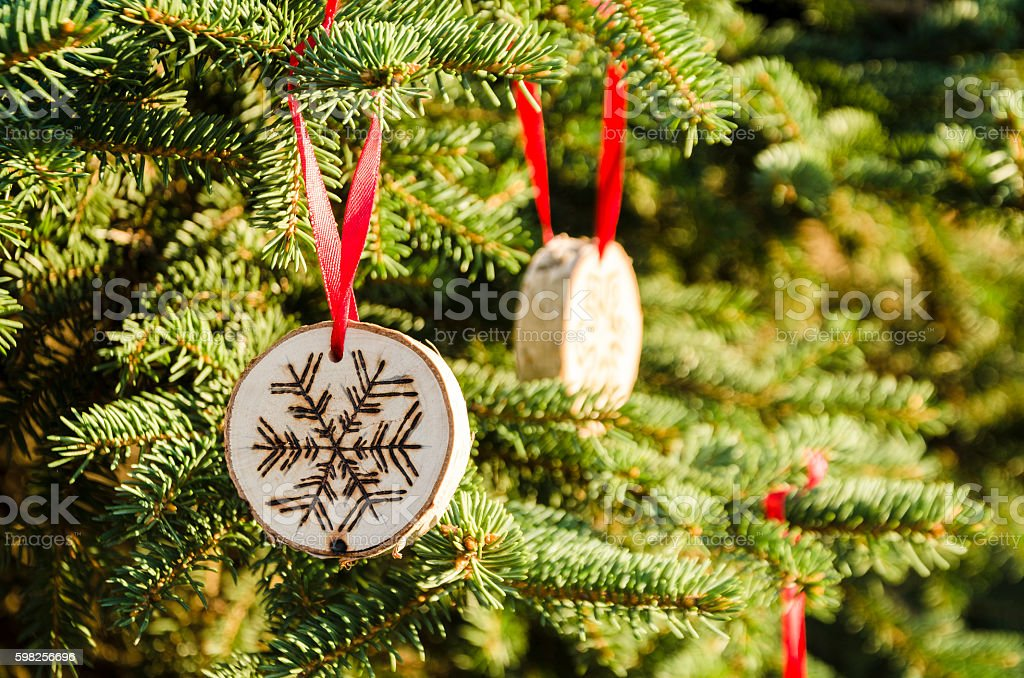 Christmas tree with hand-made decorations stock photo