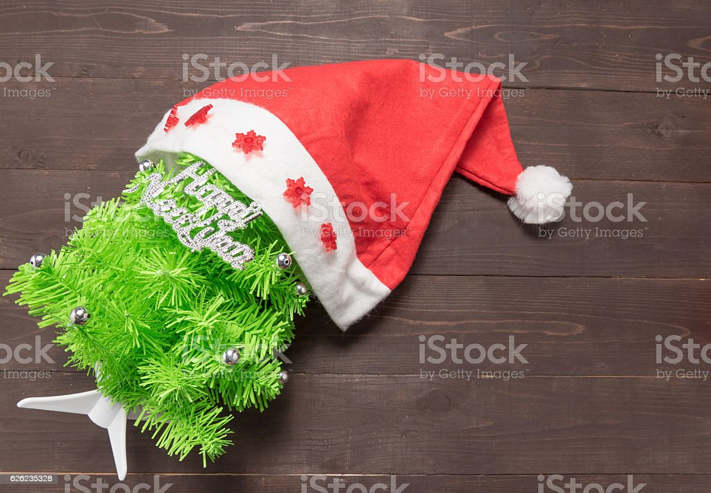 Christmas tree with Happy New Year massage and red hat stock photo