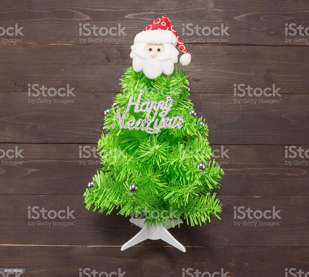 Christmas tree with Happy New Year massage and santa claus stock photo