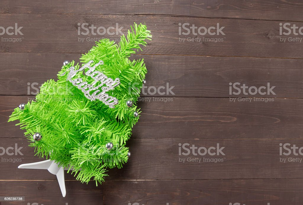 Christmas tree with Happy New Year massage on wooden background stock photo