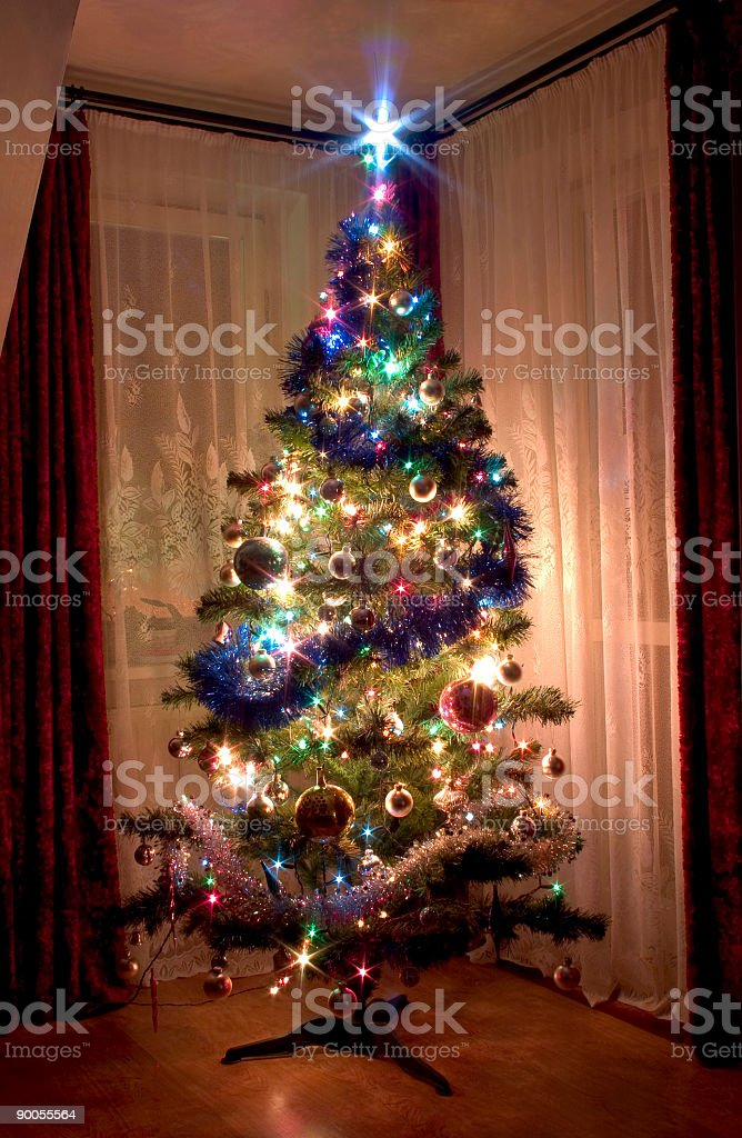 Christmas tree with lights and ornaments royalty-free stock photo