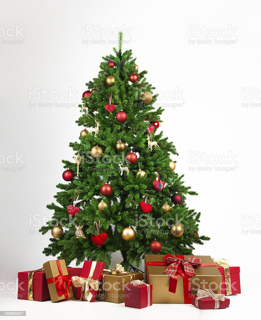 Christmas tree with many present boxes stock photo