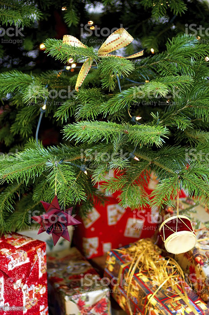 Christmas tree with presents and decorations stock photo