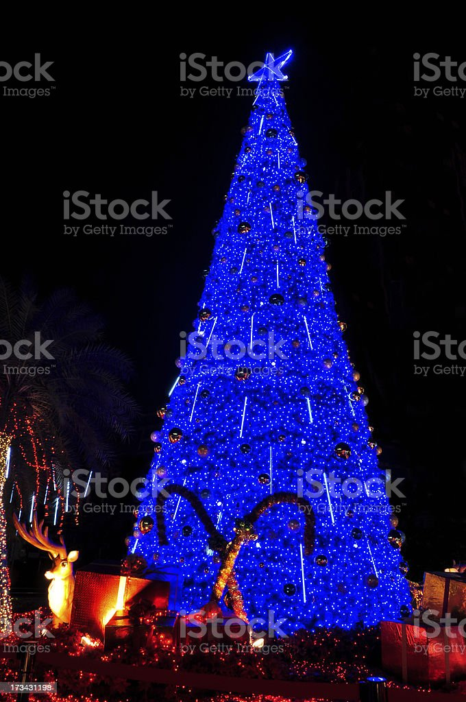 christmas tree with reindeer and gift royalty-free stock photo
