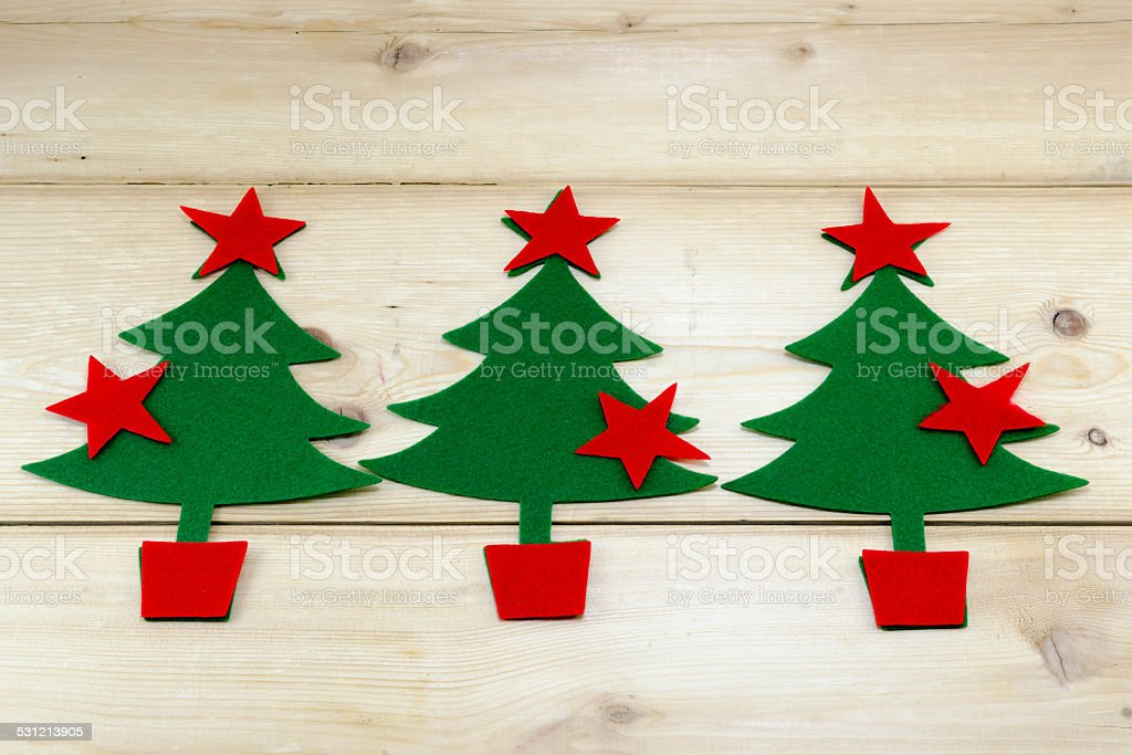 Christmas trees and stars on a wooden table royalty-free stock photo