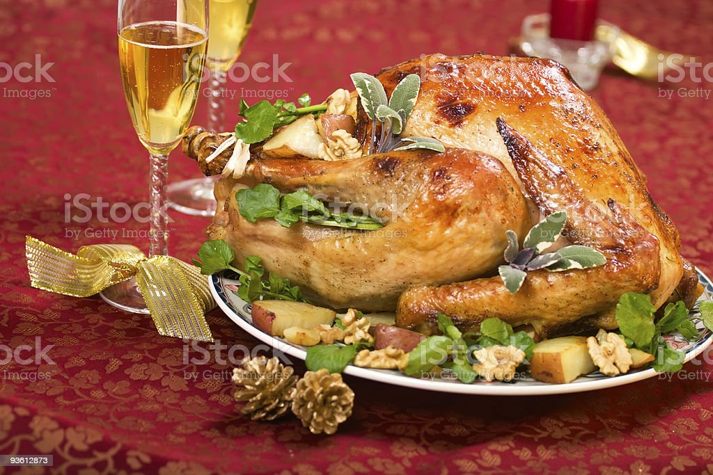 Christmas turkey on holiday table and flute of champagne royalty-free stock photo