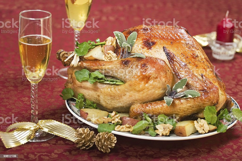 Christmas turkey on holliday table and flute of champagne stock photo