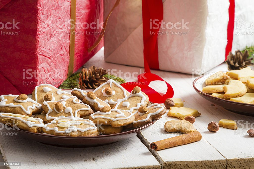 Christmas view on the table full of gifts and cookies royalty-free stock photo