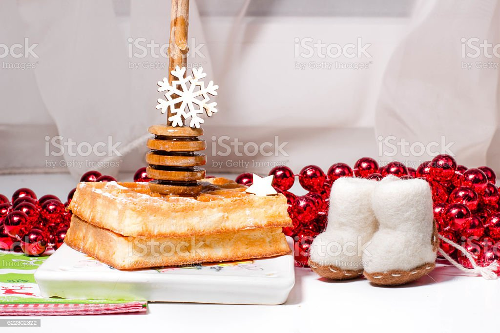 Christmas waffle with honey on ceramic plate stock photo