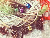 Christmas willow wreath with fir branches and Christmas toys