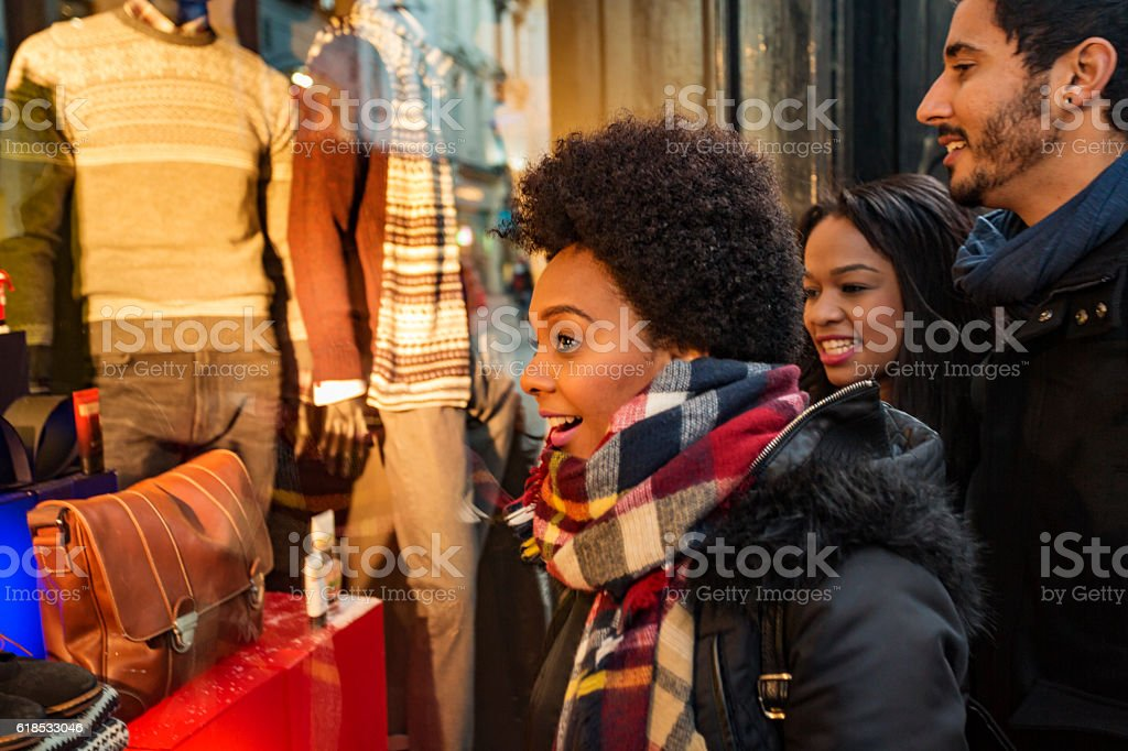 Christmas Window Shopping Group of Happy Friends stock photo