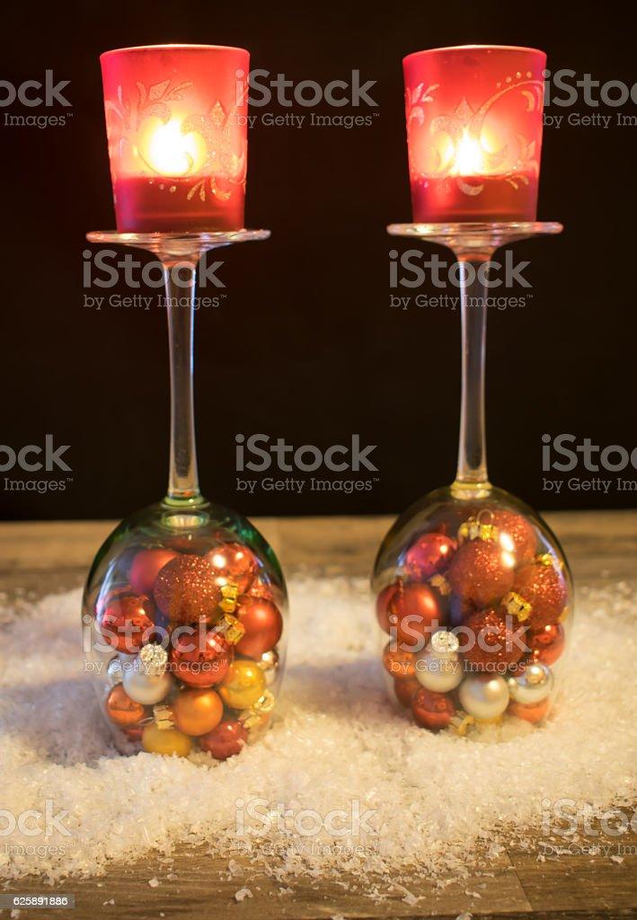 Christmas, wine glasses with Christmas balls and tea light stock photo