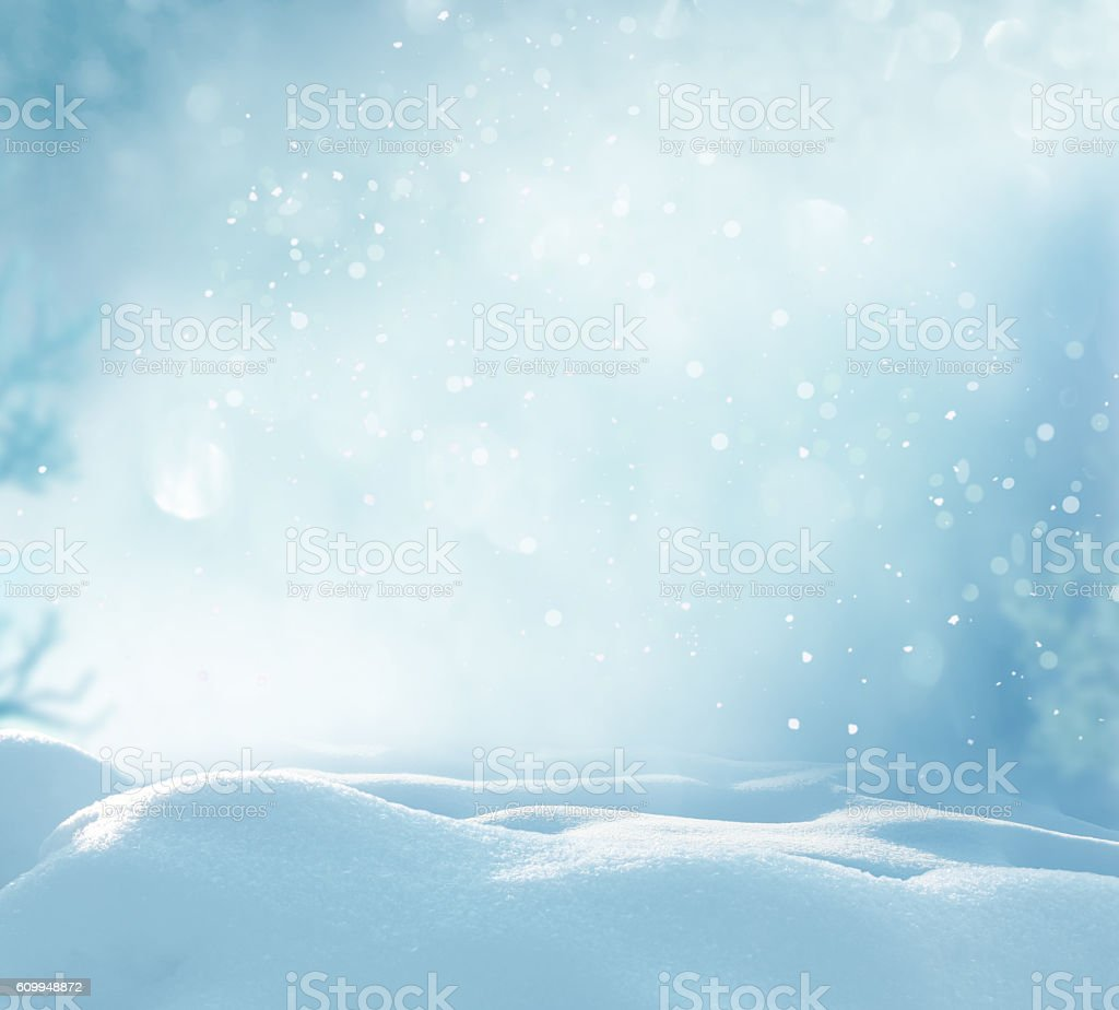 Christmas winter background with snow and blurred bokeh stock photo