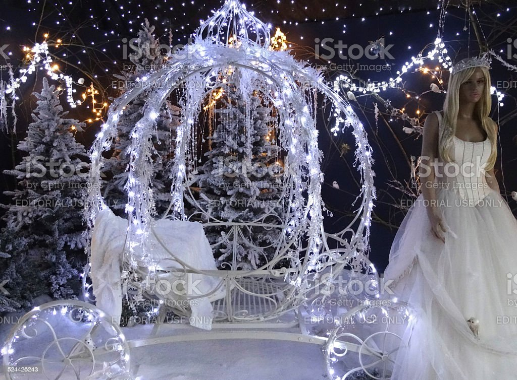 Christmas winter display, Cinderella princess with pumpkin carriage, snow, fairy-lights stock photo