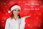 Christmas Woman. Beautiful fashion model with hat Santa Claus.