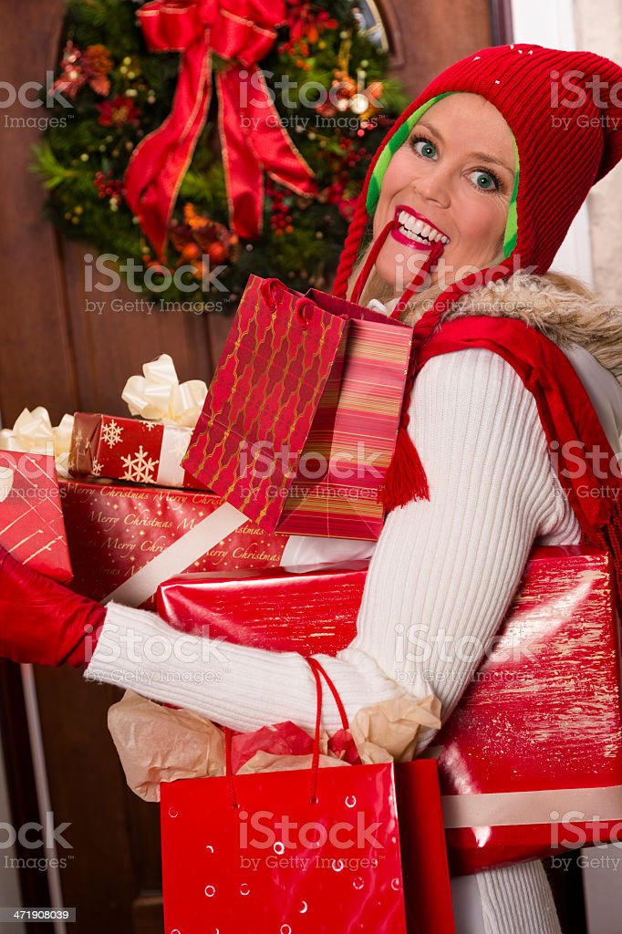 Christmas:  Woman brings many gifts home after shopping day. royalty-free stock photo