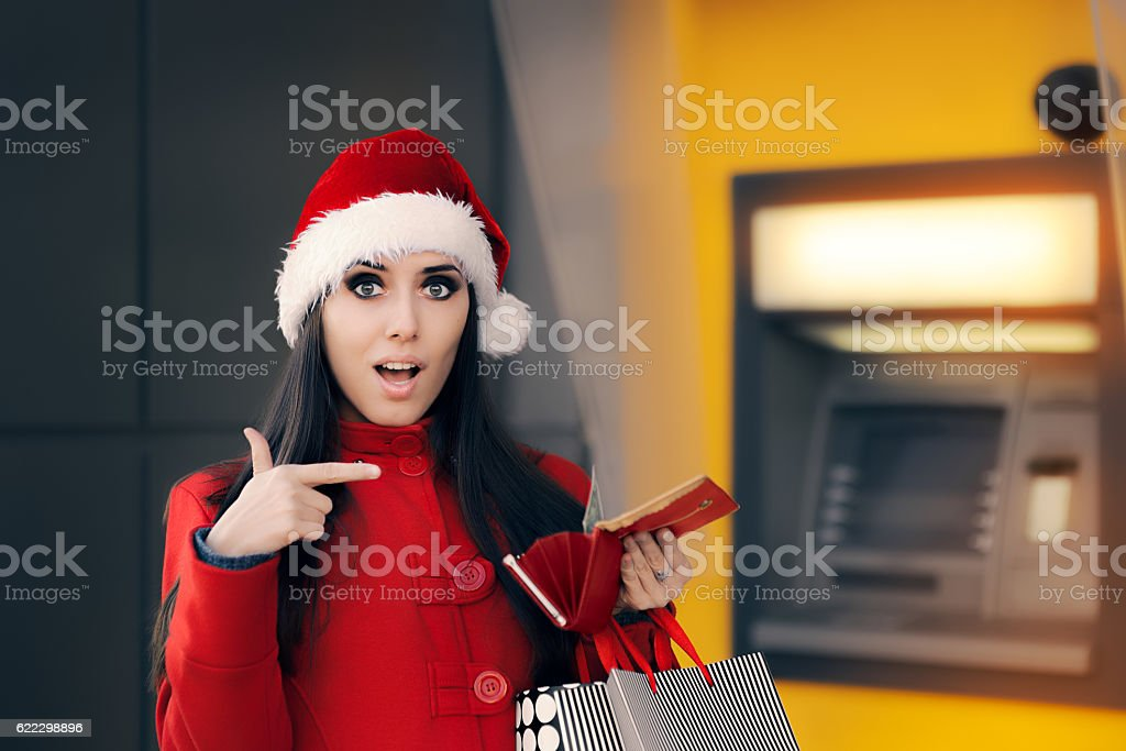 Christmas Woman Checking her Wallet stock photo