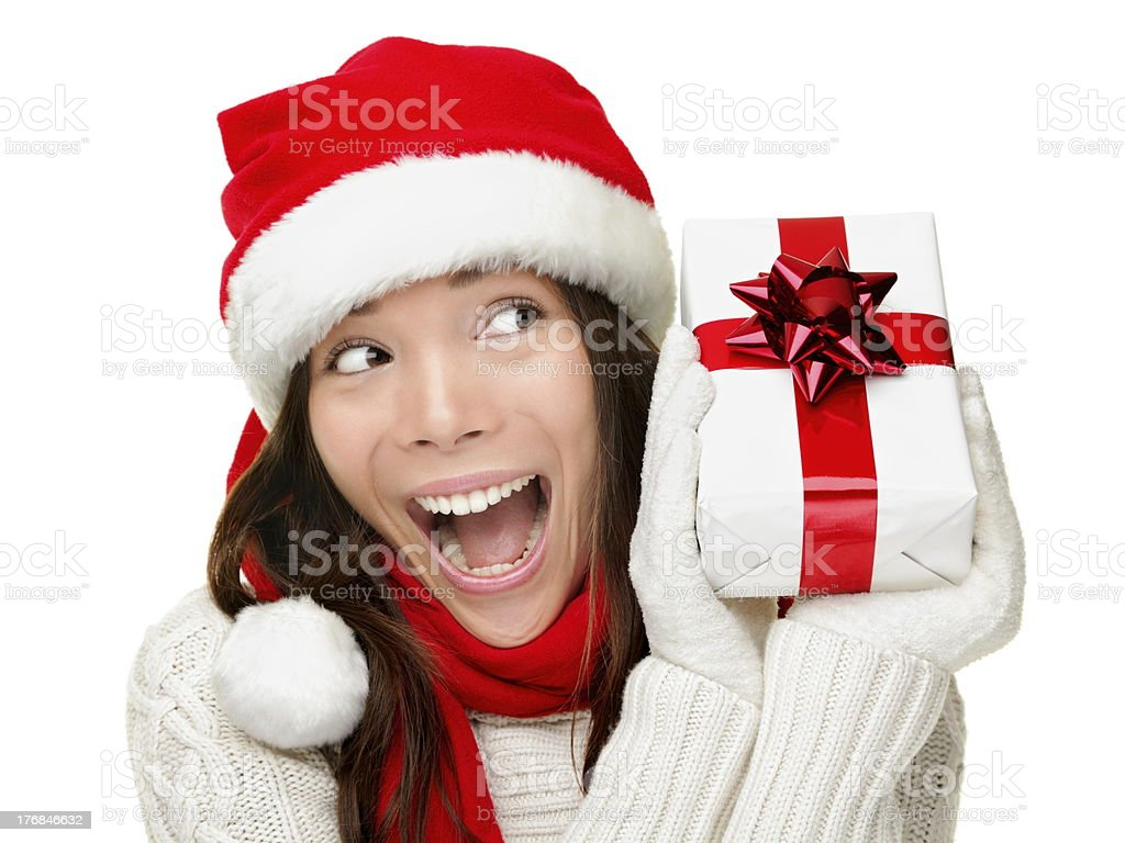 Christmas woman holding present excited royalty-free stock photo