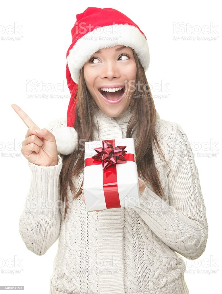 Christmas woman pointing up stock photo