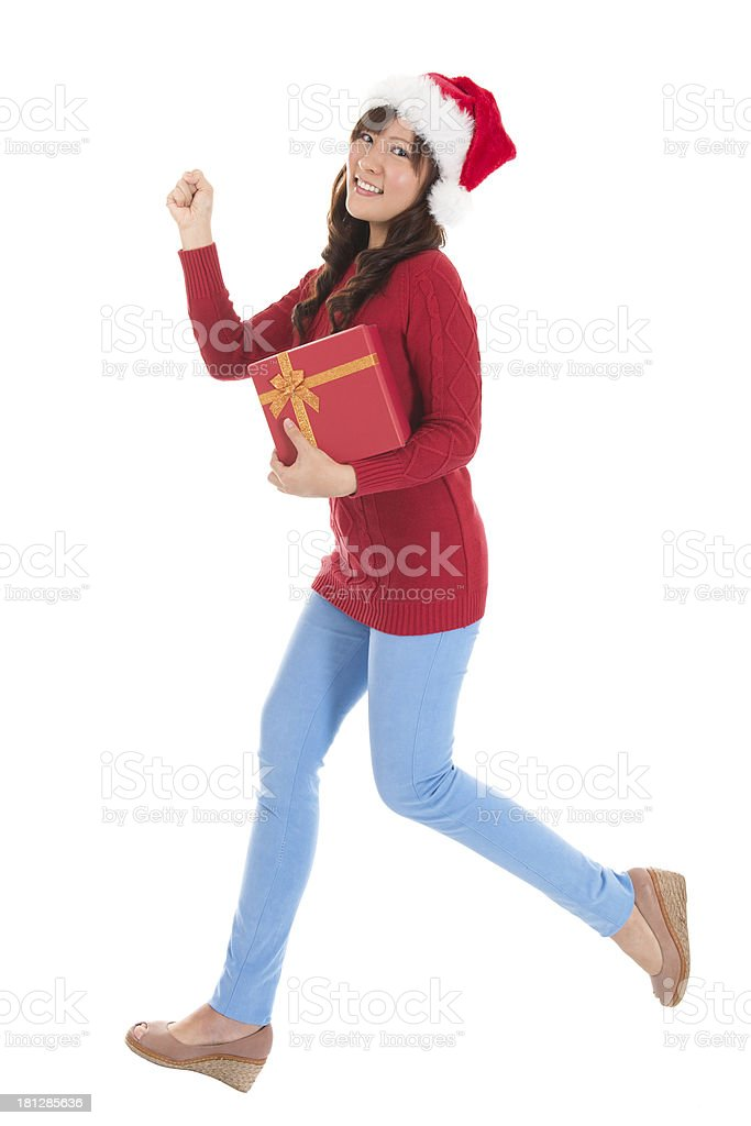 Christmas woman running with gift royalty-free stock photo