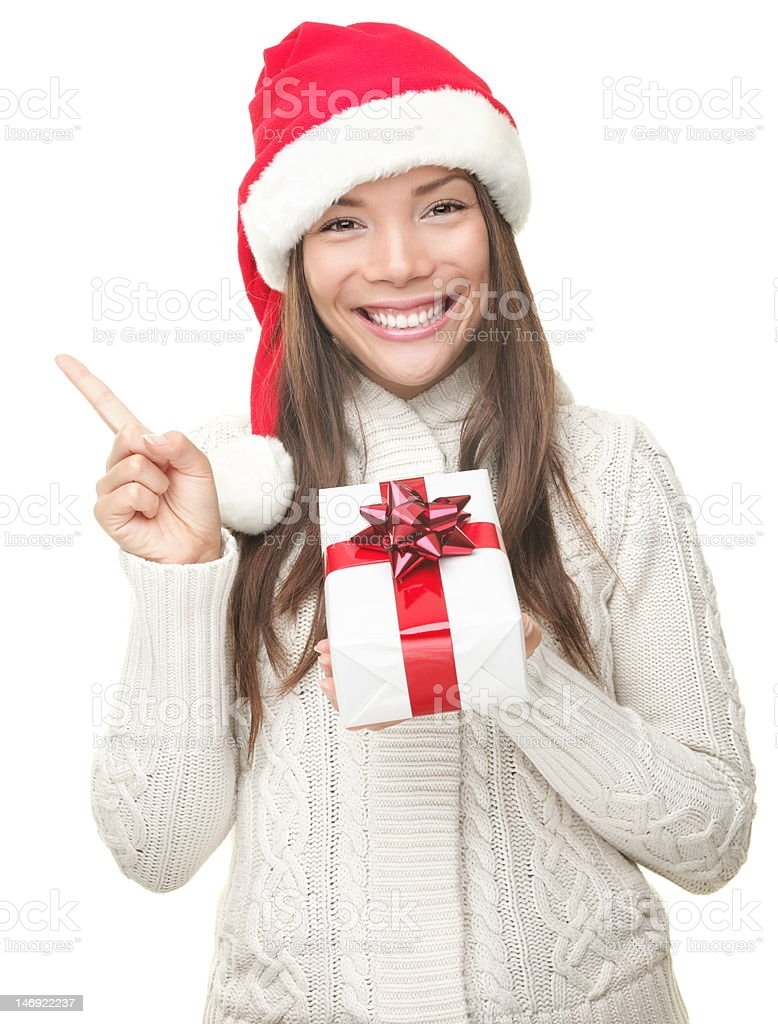 Christmas woman showing copy space stock photo