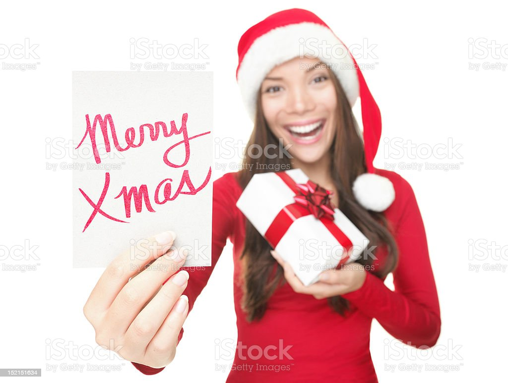 Christmas woman showing copy space sign royalty-free stock photo