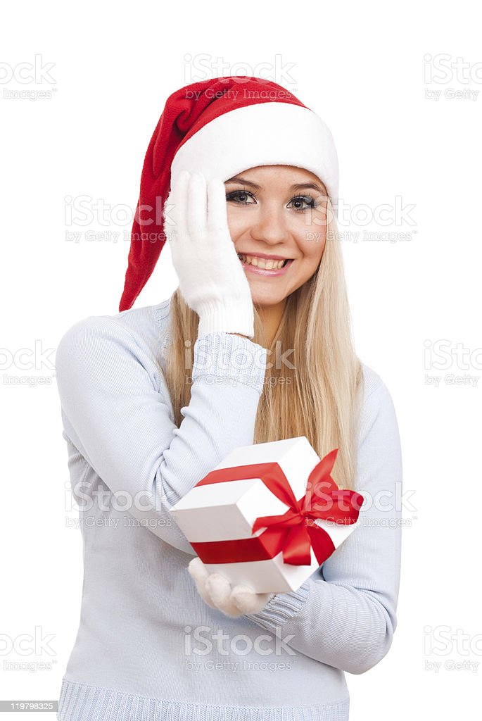 Christmas woman with gift smiling stock photo