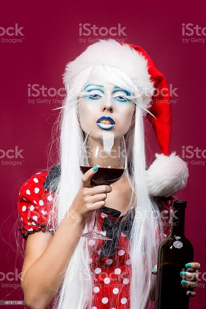Christmas woman with wine stock photo