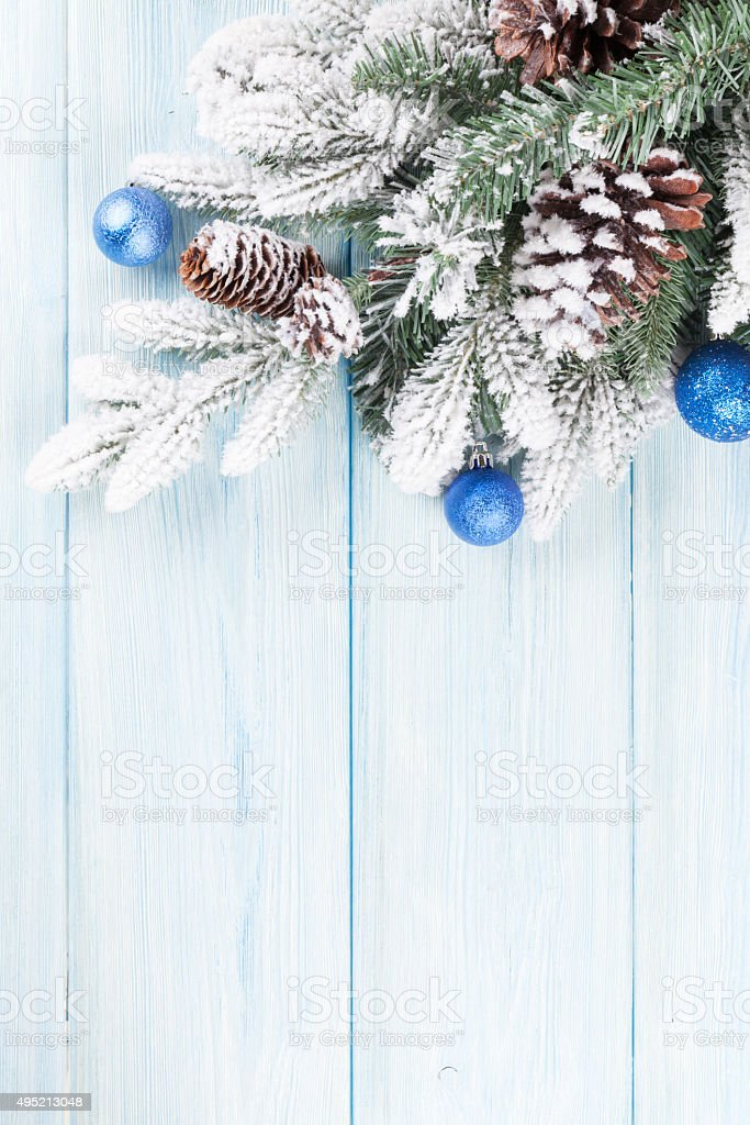 Christmas wooden background with fir tree and decor stock photo