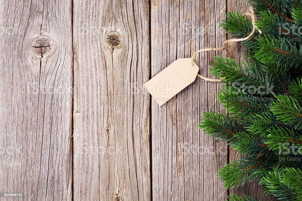 Christmas wooden background with fir tree stock photo