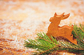 Christmas wooden background with gold hand painted deer ornament