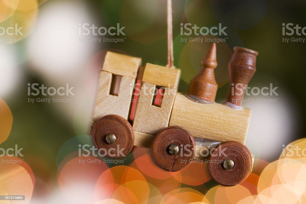 Christmas Wooden Train Ornament Hanging with Tree Lights, Copy Space stock photo