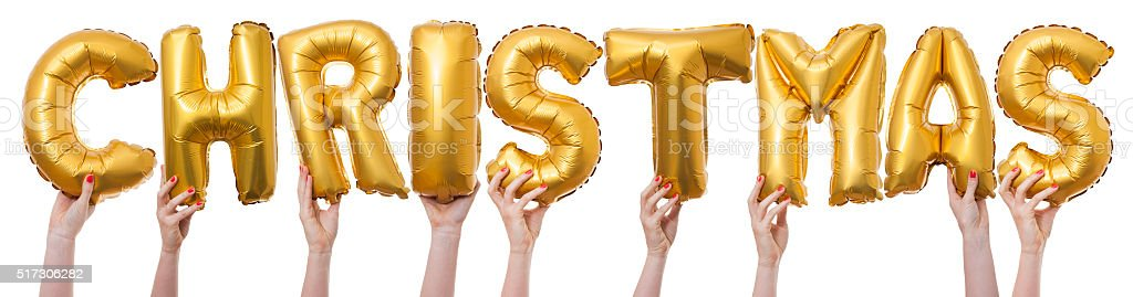 Christmas word made from gold balloons stock photo
