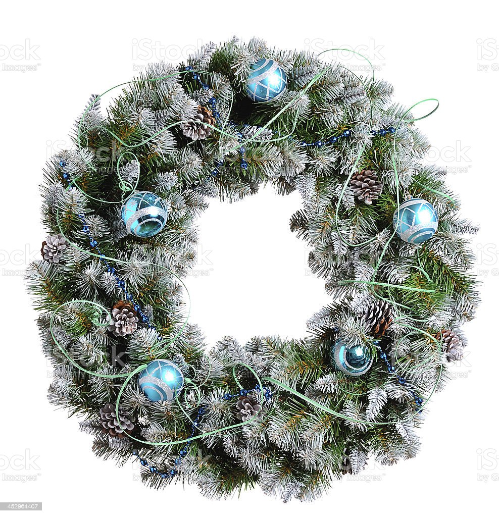 A Christmas wreath decorated with cones, baubles and ribbon stock photo
