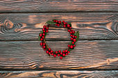 Christmas wreath decorated with red berries