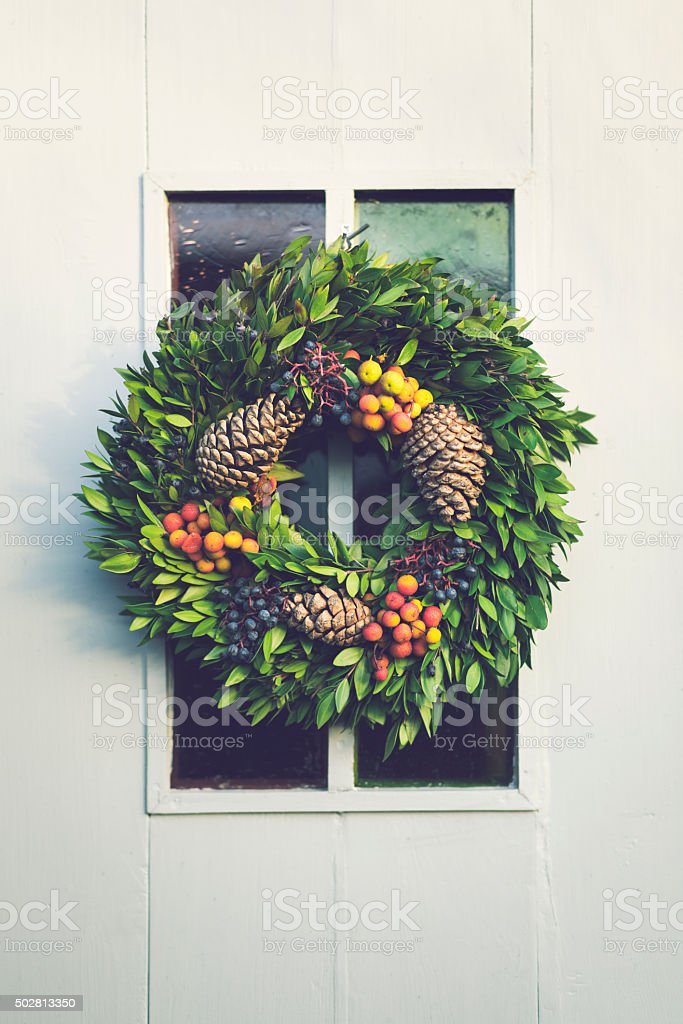 Christmas wreath decoration hanging on door stock photo