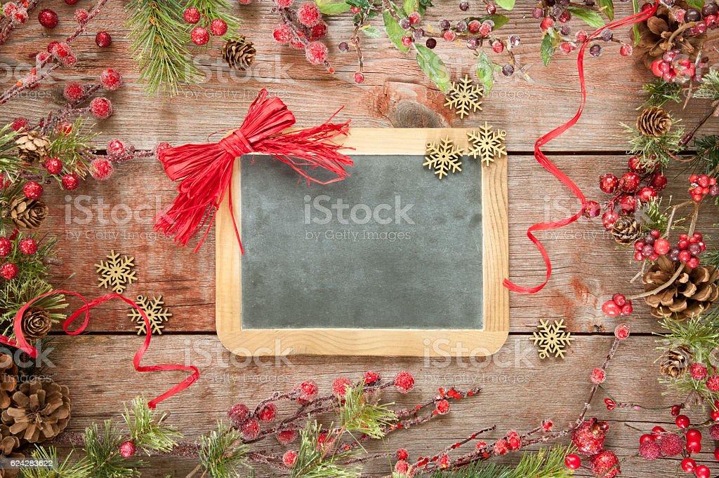 Christmas Wreath Garland Border Frame on Old Wood Background stock photo