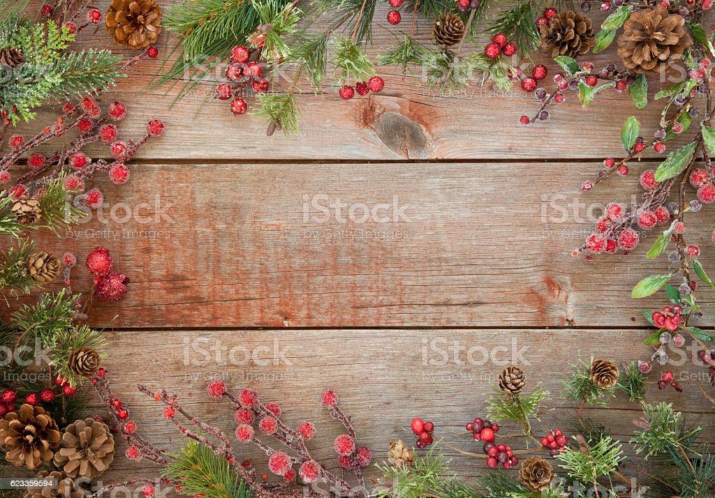 Christmas Wreath Garland on an Old Rustic Barn Door Background stock photo