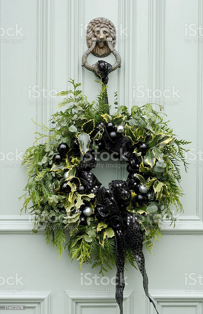 Christmas wreath hanging from lion head door knocker royalty-free stock photo