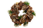 Christmas wreath of cones. Christmas decorations. Isolated.