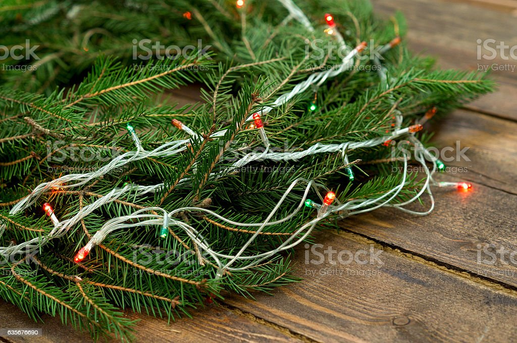 Christmas wreath of tree branches on wooden background stock photo