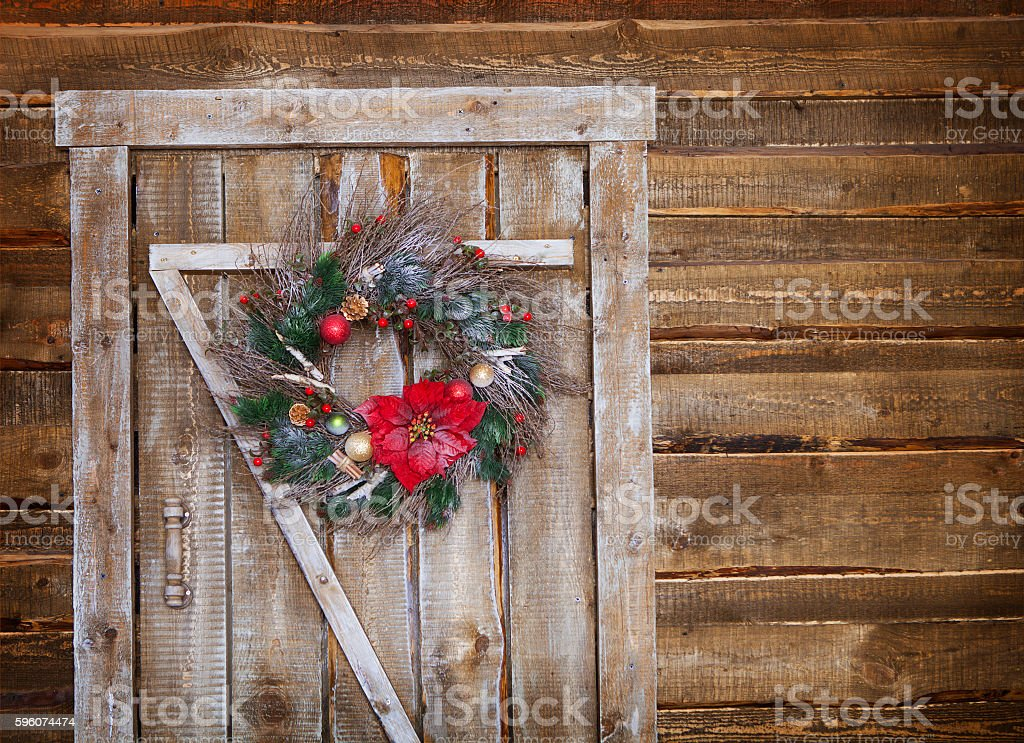 Christmas wreath on a rustic wooden door stock photo