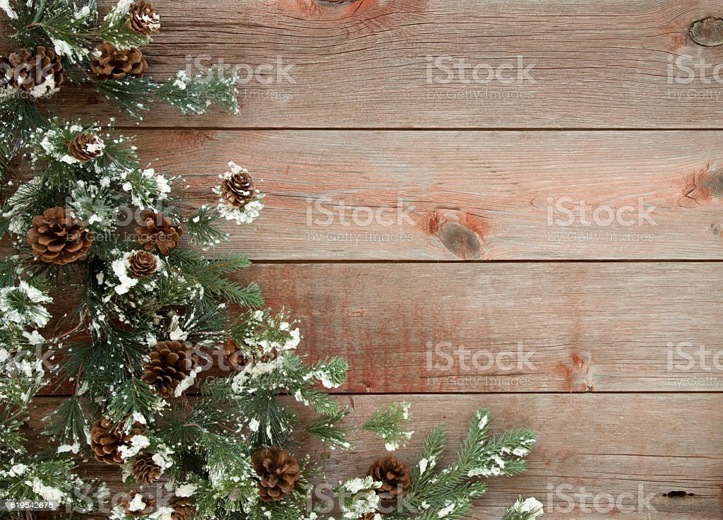 Christmas Wreath on an Old Rustic Barn Door Background stock photo