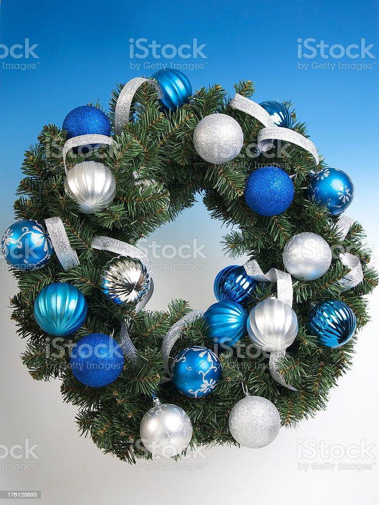 Christmas Wreath  on Blue Background stock photo