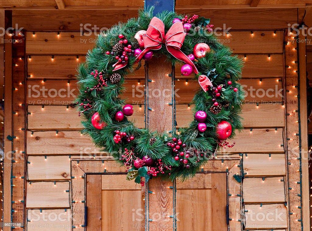 Christmas Wreath on natural wood doorway stock photo