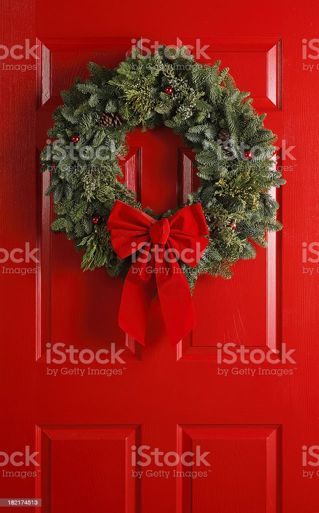Christmas Wreath on Red Door royalty-free stock photo