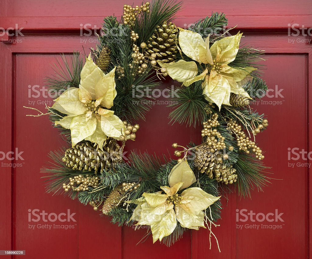 Christmas wreath on red painted door stock photo