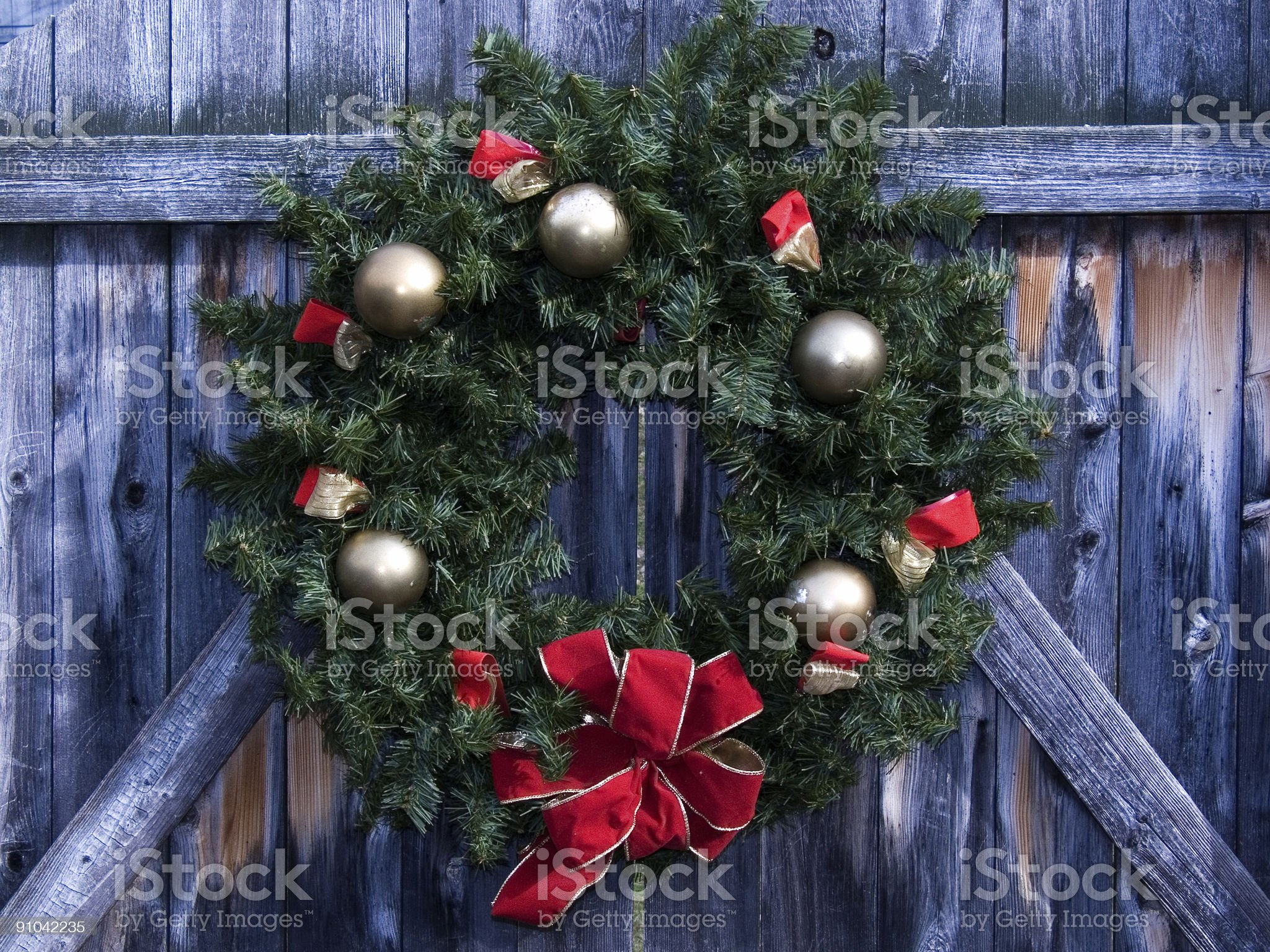 Christmas Wreath on Rustic Wooden Fence royalty-free stock photo